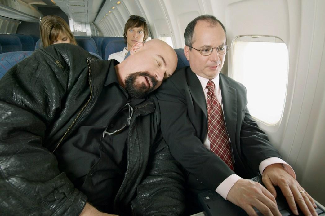 Man har somnat på passagerare vid sidan om honom på flyg